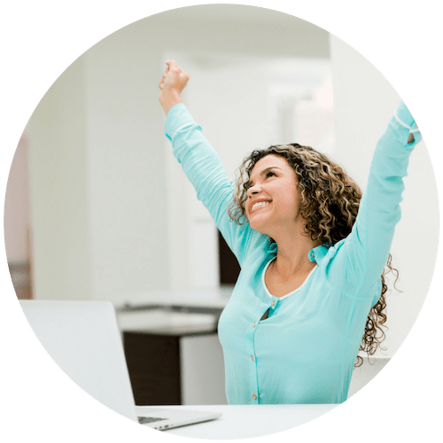 woman with her arms up and smiling with success