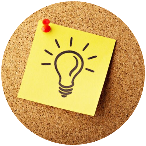 a post-it note with a lightbulb drawn on it to represent an idea