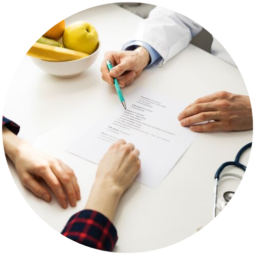 doctor discussing a written plan with a patient
