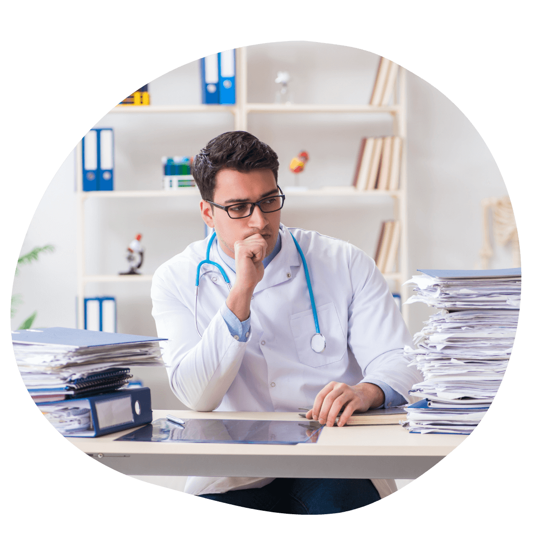 image of a male doctor sitting in his office